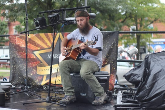 Tom Burton performs at the festival's Hometown Talent Stage on Saturday.