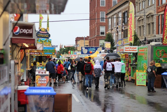 People brave the rain during the 38th annual Marion Popcorn Festival on Saturday.