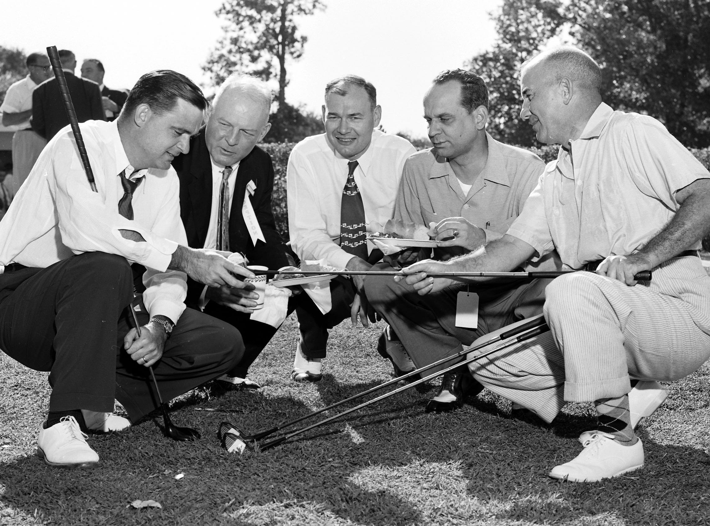 The talk was more golf than law when legal heads assembled at Chickasaw Country Club on 12 Sep 1955 for the annual Memphis and Shelby County Bar Association picnic.  Looking over new clubs were (From Left) Jack Petree, Cooper Turner, George O. Benton of Jackson, TN, Ben Adams and Charles G. Black.