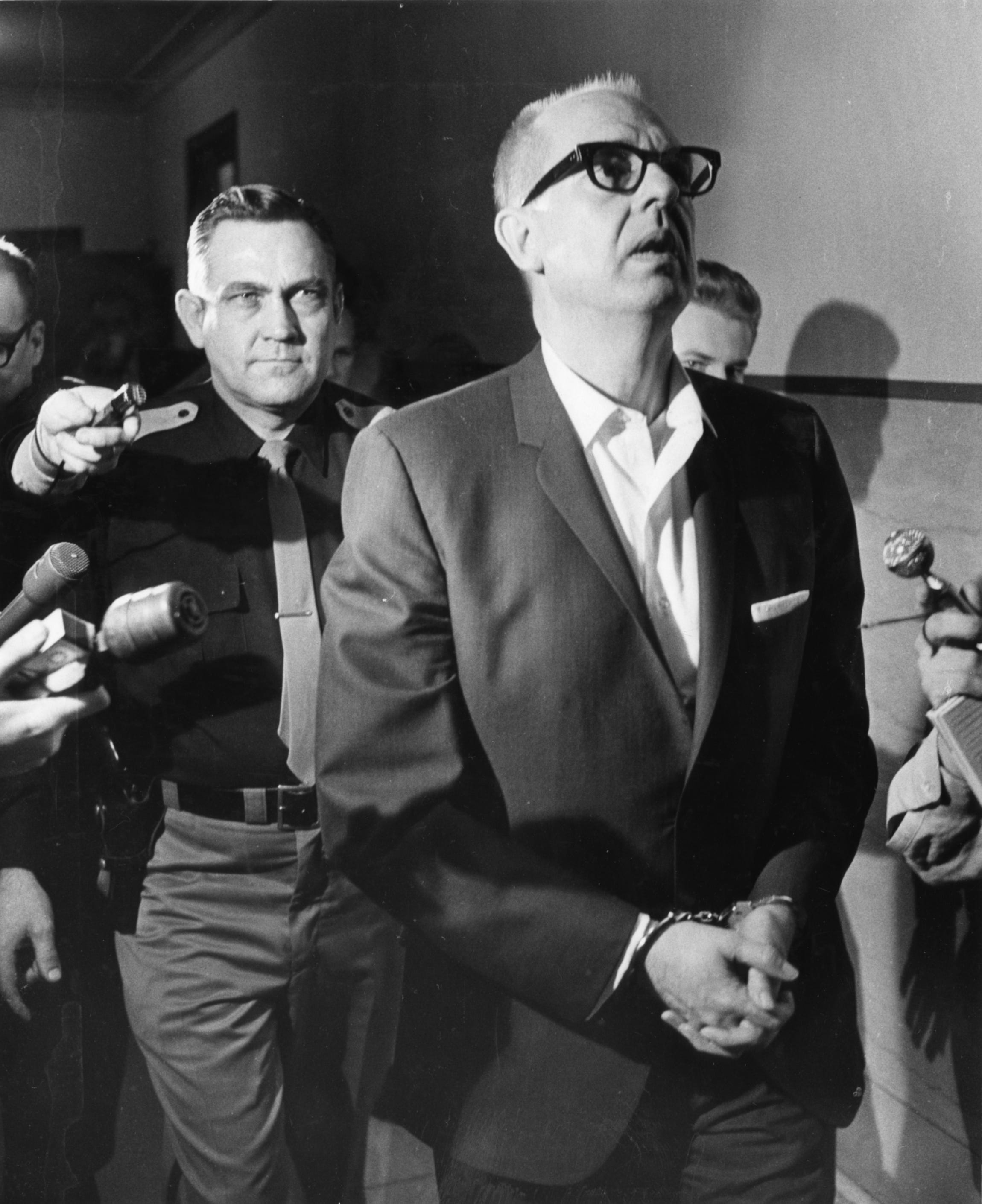 August K. Bergenthal, a wealthy suburban Milwaukee business executive, is led from the courtroom after a jury found him sane when he shot and killed Universal Foods Chairman Russell D.L. Wirth in the latter's East Side home on Sept. 20, 1968. Bergenthal was convicted of first-degree murder; the jury ruled he was sane on April 14, 1969.