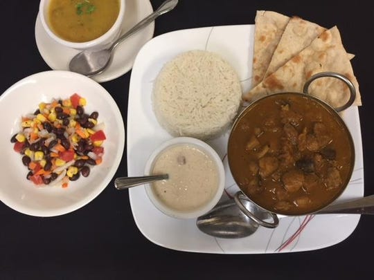 Lunch specials like the Chicken Mushroom are served with soup, chef's choice salad, naan, white rice and dessert.