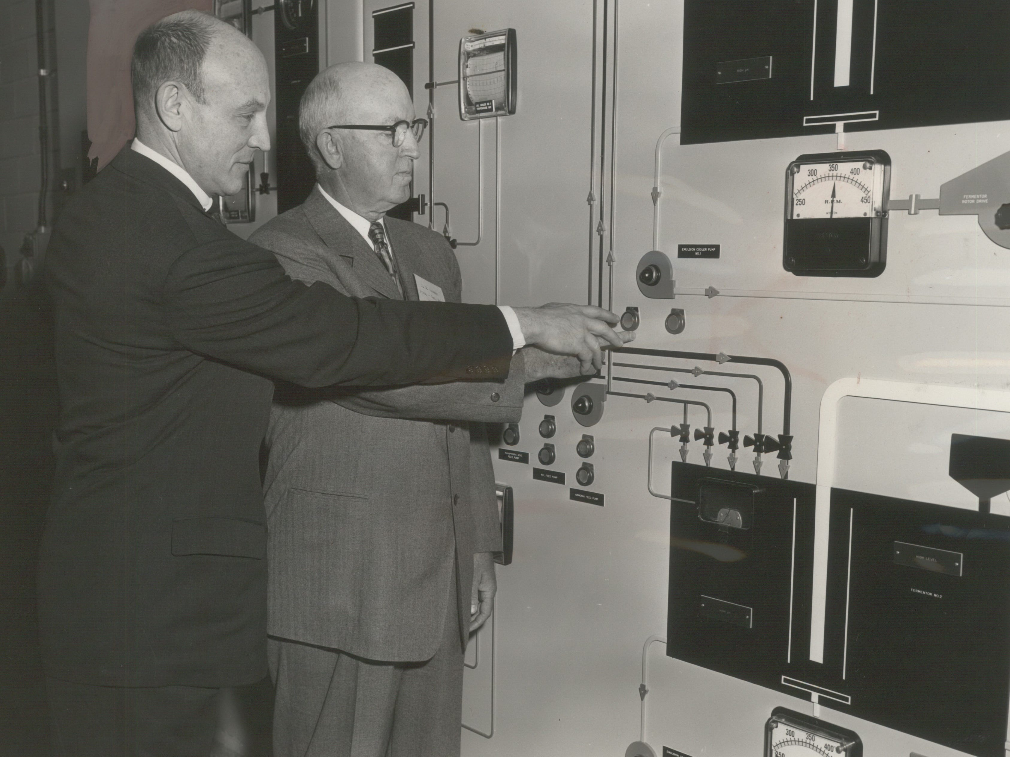 Russell D.L. Wirth (left), president of what was then Red Star Yeast Co., looks on as Charmin Paper Mills President J.M. Conway pushes the button to start production at a new torula yeast plant in Green Bay on April 14, 1955. Under Wirth's leadership Red Star Yeast expanded and diversified, acquiring Universal Foods and adopting that company's name in 1961. This photo was published in the April 15, 1955, Milwaukee Journal.