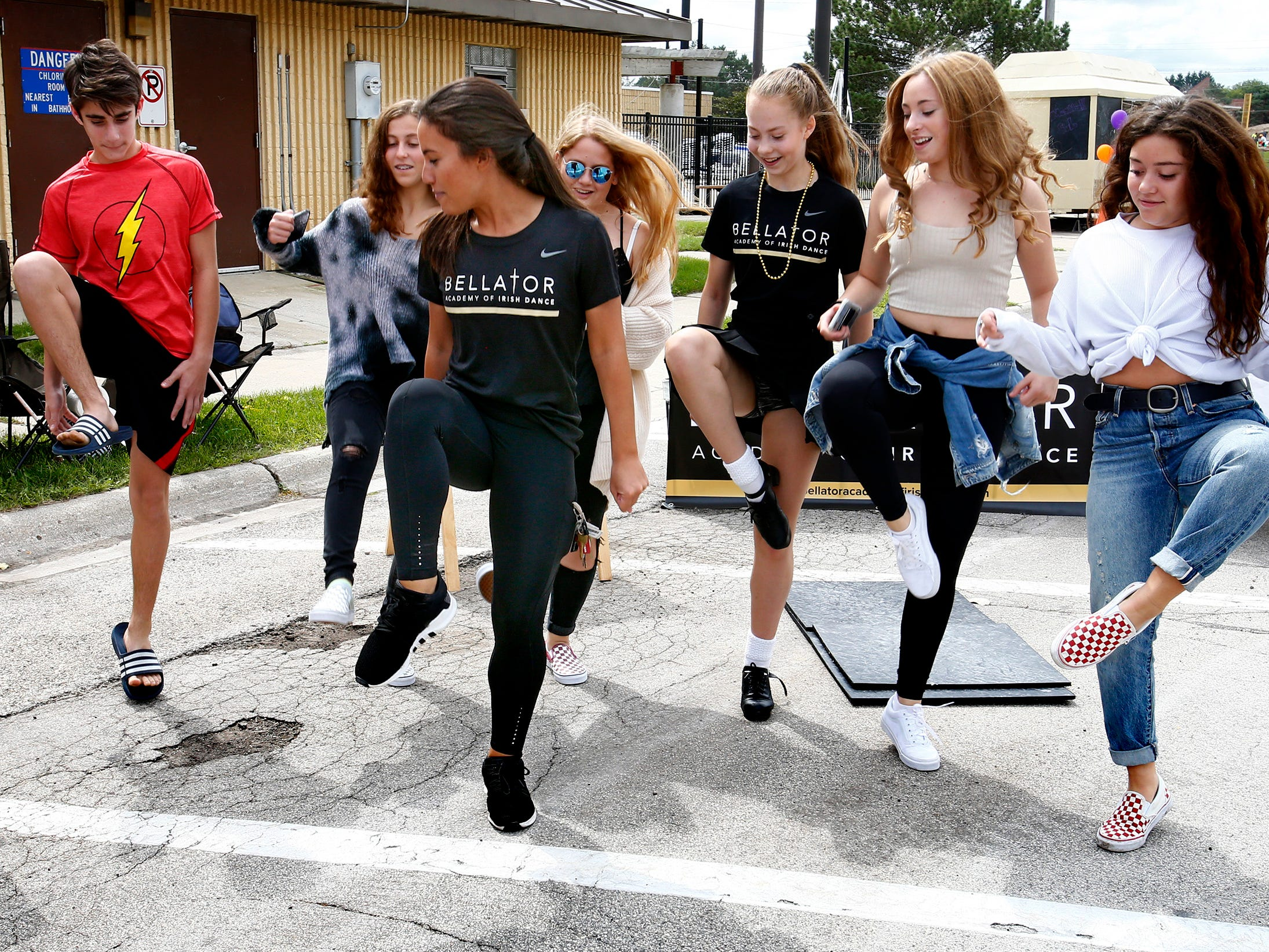 Chelsea Holloway of Bellator Academy of Irish Dance leads a group through a dance step sequence during the sixth annual Taste of Mequon in the vicinity of City Hall and on Cedarburg Road on Sept. 8.