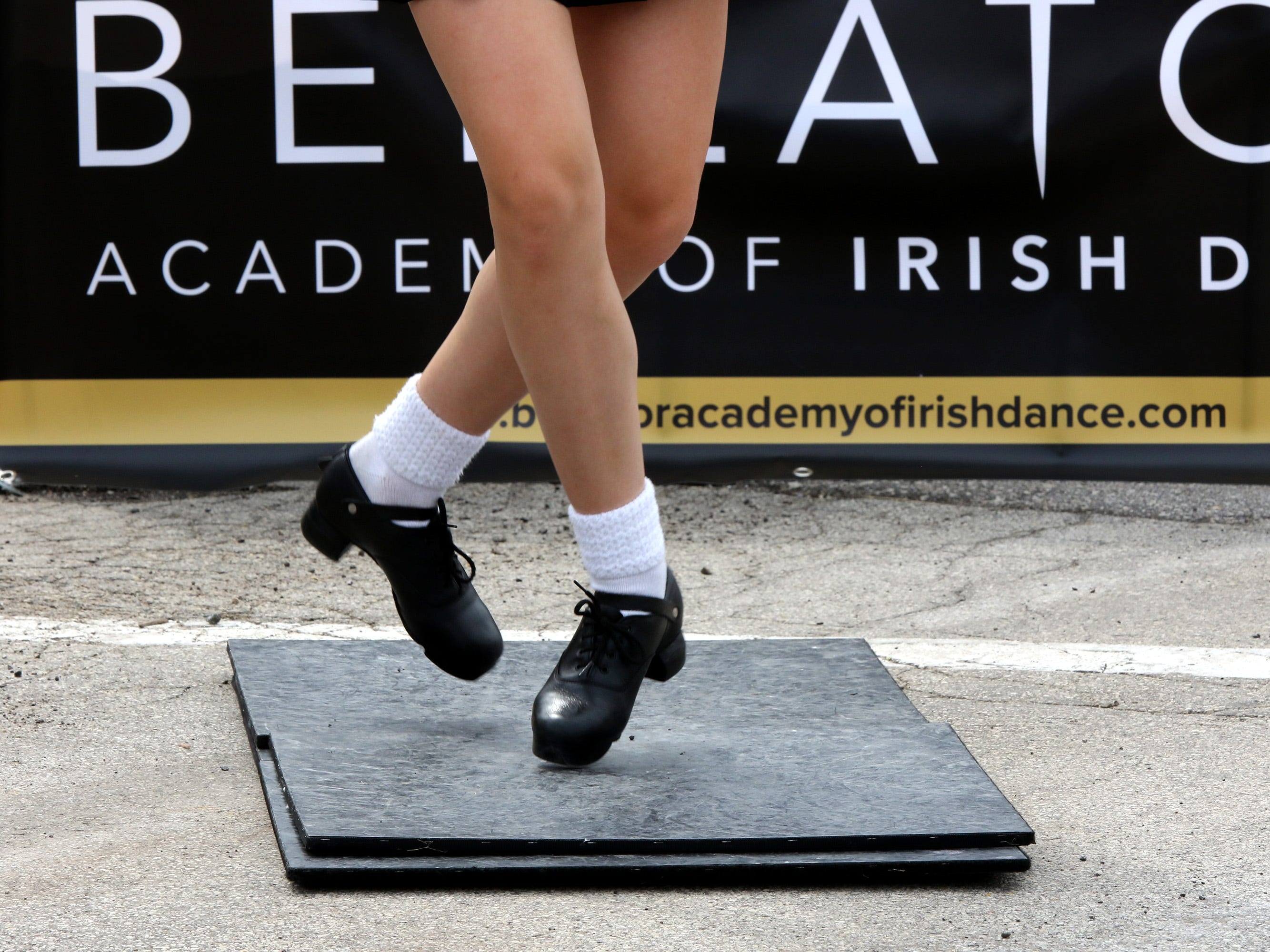 Callie Johnson of Mequon, a student of Bellator Academy of Irish Dance, demonstrates a dance step during the sixth annual Taste of Mequon in the vicinity of City Hall and on Cedarburg Road on Sept. 8.