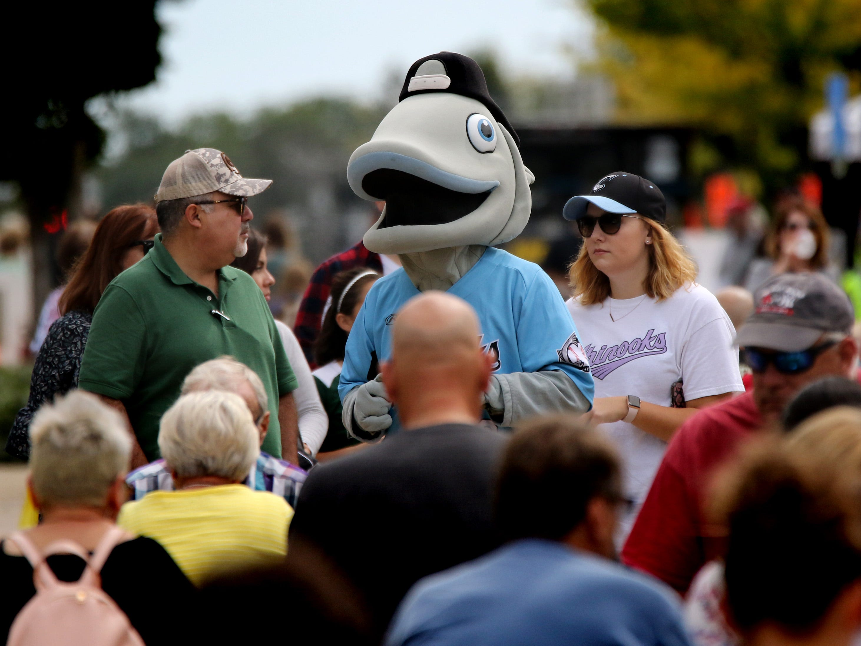 The mascot of the Lakeshore Chinooks baseball team of the Northwoods League wanders the crowd during the sixth annual Taste of Mequon in the vicinity of City Hall and on Cedarburg Road on Sept. 8.