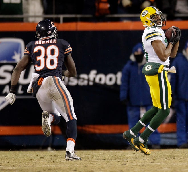 Green Bay Packers wide receiver Randall Cobb (18) scores the game-winning touchdown on a 48-yard touchdown reception during the fourth quarter of their game Sunday, December 29, 2013 at Soldier Field in Chicago, Ill. The Green Bay Packers beat the Chicago Bears 33-28 to win the NFC north division. Covering Cobb was Chicago Bears cornerback Zack Bowman (38).
