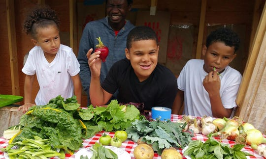 Youth show off their produce made as part of the Victory Garden Initiative, a Milwaukee-based organization.