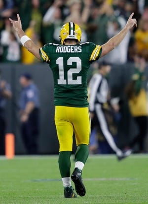 Aaron Rodgers celebrates the game-winning touchdown pass to Randall Cobb late in the fourth quarter on Sunday night.