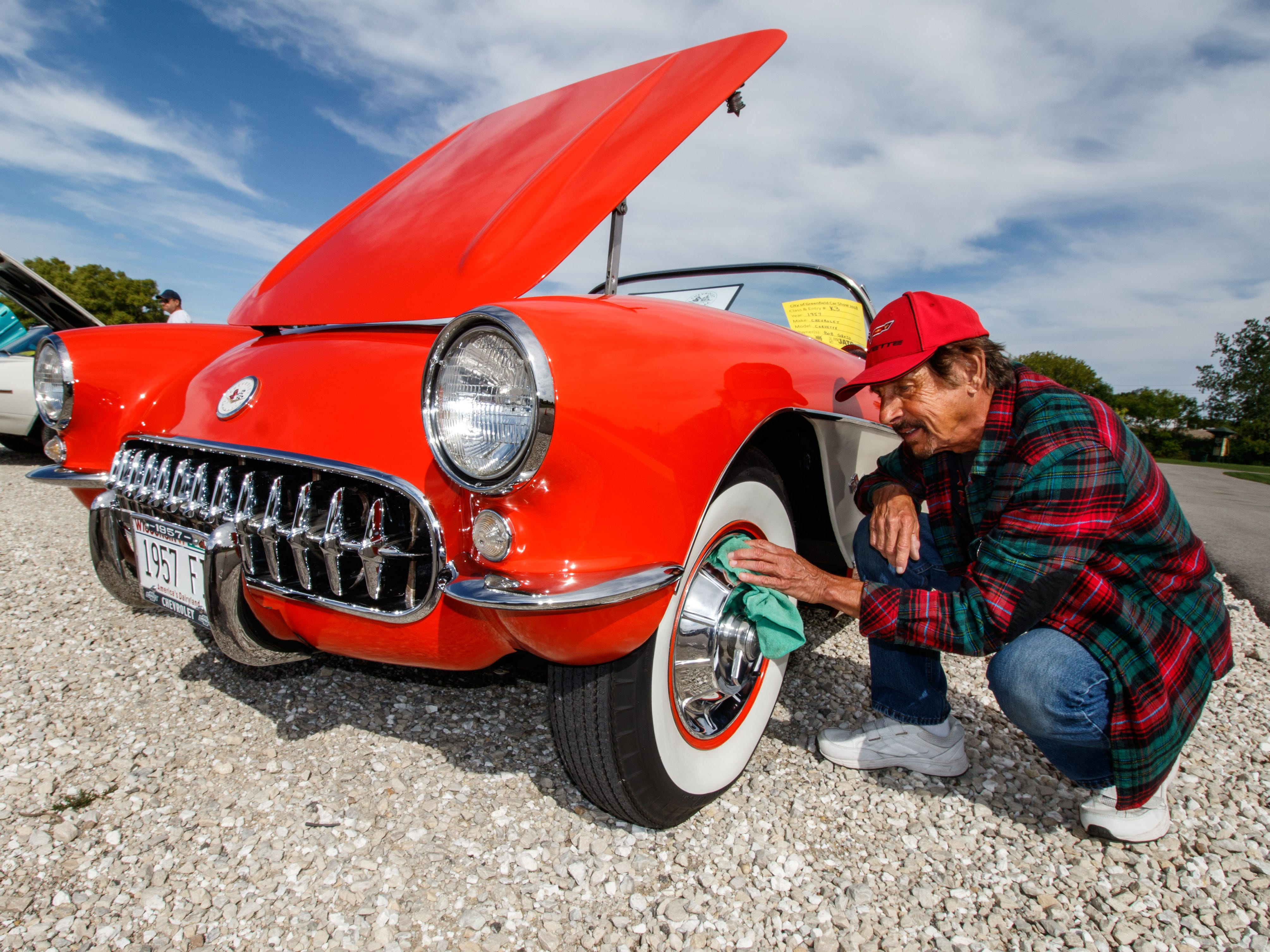 Bob Gross of New Berlin adds a last minute shine to his immaculate 1957 Chevrolet Corvette during the City of Greenfield's 2nd annual Car Show in Konkel Park on Saturday, Sept. 8, 2018.