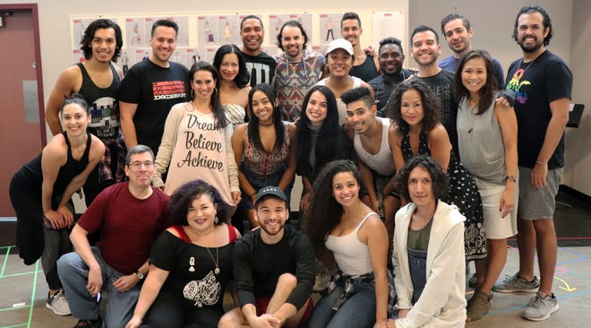 """The cast of Milwaukee Repertory Theater's """"In The Heights"""" stops for a photo with director May Adrales (middle row, far right)."""