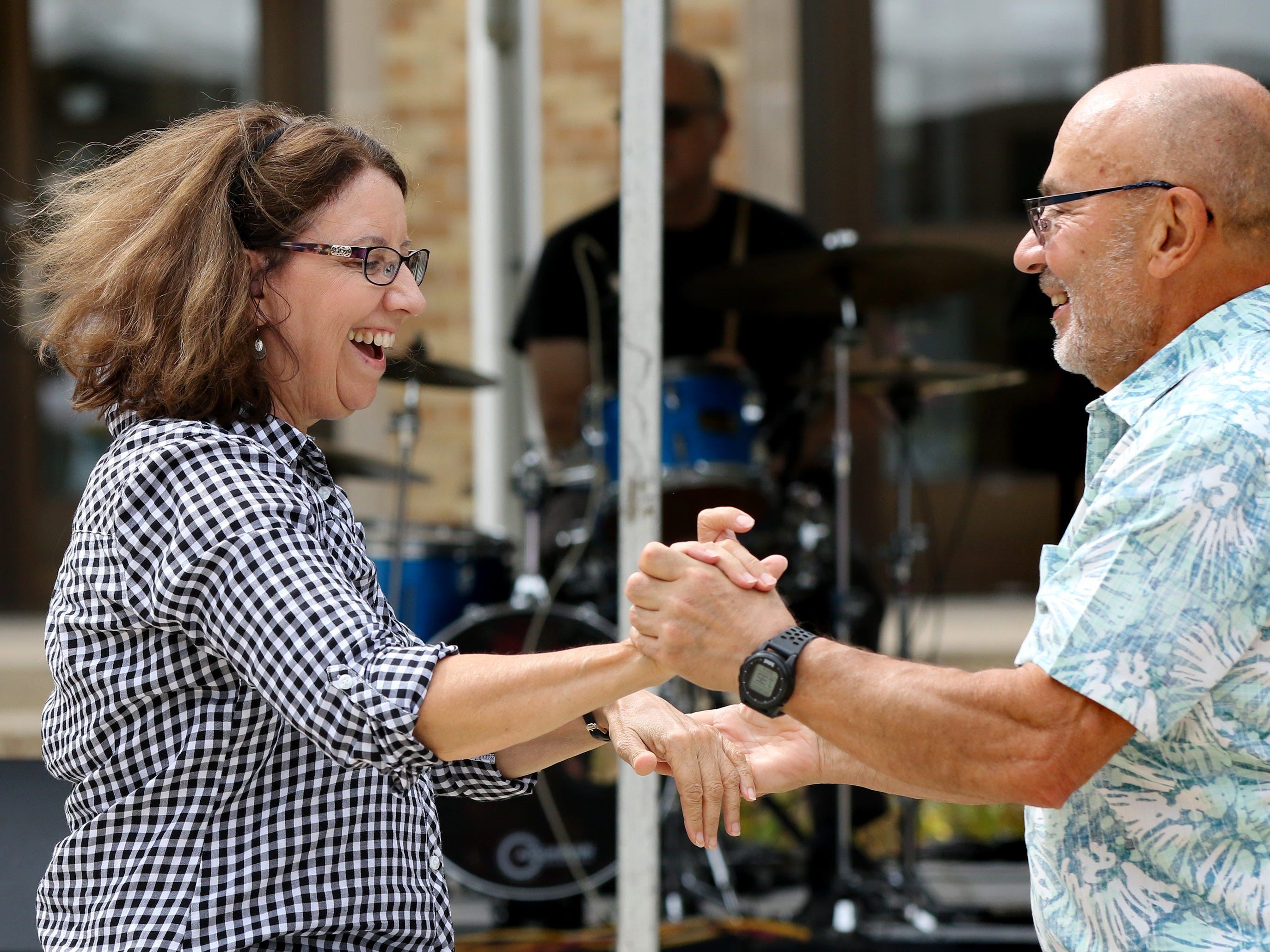 LuAnne Salmon and James Aveni dance to the sounds of the Danny Miller Band during the sixth annual Taste of Mequon in the vicinity of City Hall and on Cedarburg Road on Sept. 8.