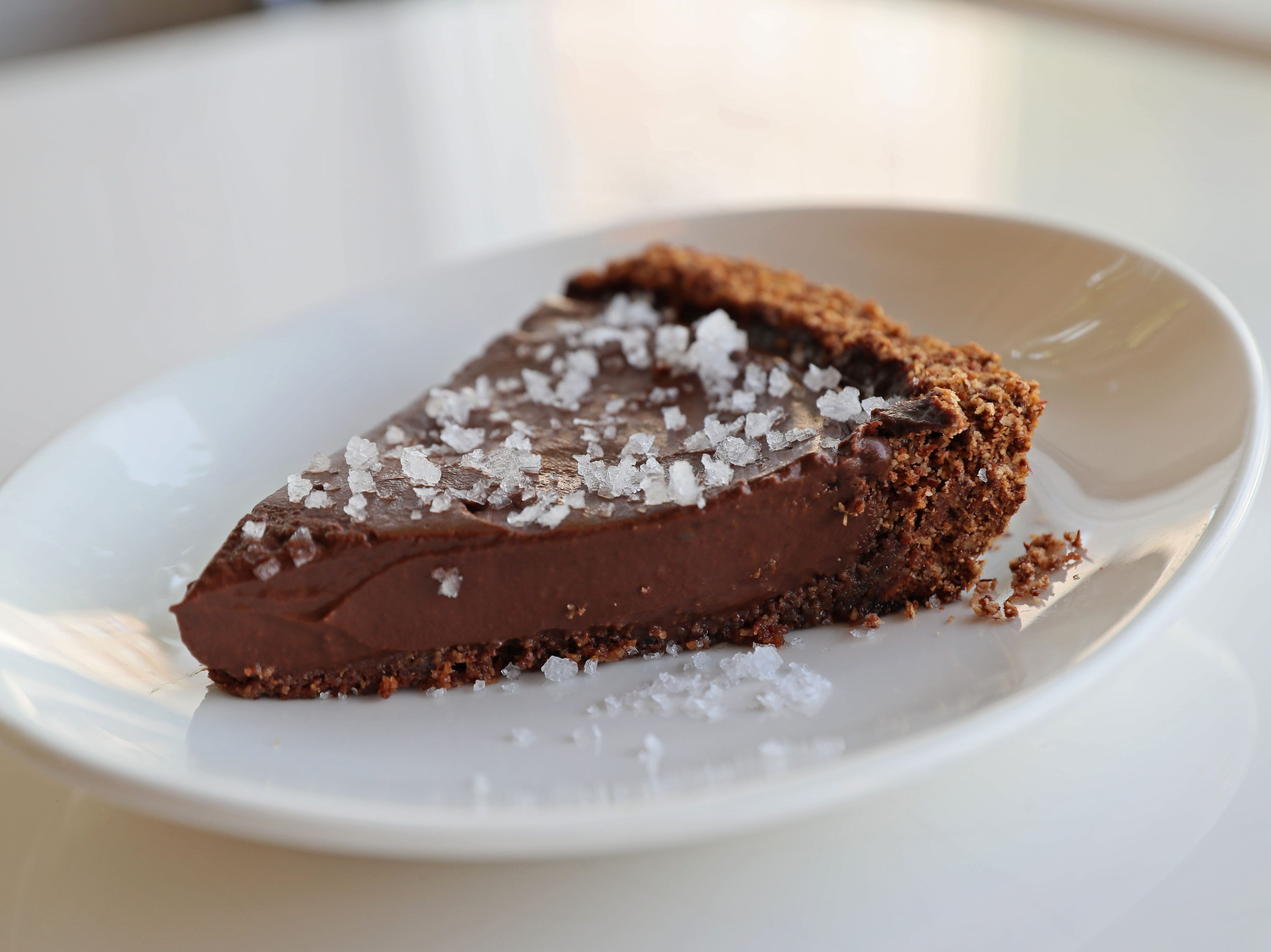 The chocolate salted tart has sweet plate appeal at Celesta.