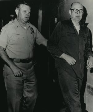 Fox Point investor August K. Bergenthal, 47, accused of shooting industrialist Russell D.L. Wirth to death in Milwaukee, is taken to his cell in the San Diego city jail after questioning. He was arrested on Sept. 21, 1968, the day after he allegedly shot and killed Wirth, a former associate. This photo was published in both the Milwaukee Sentinel and Milwaukee Journal on Sept. 23, 1968.