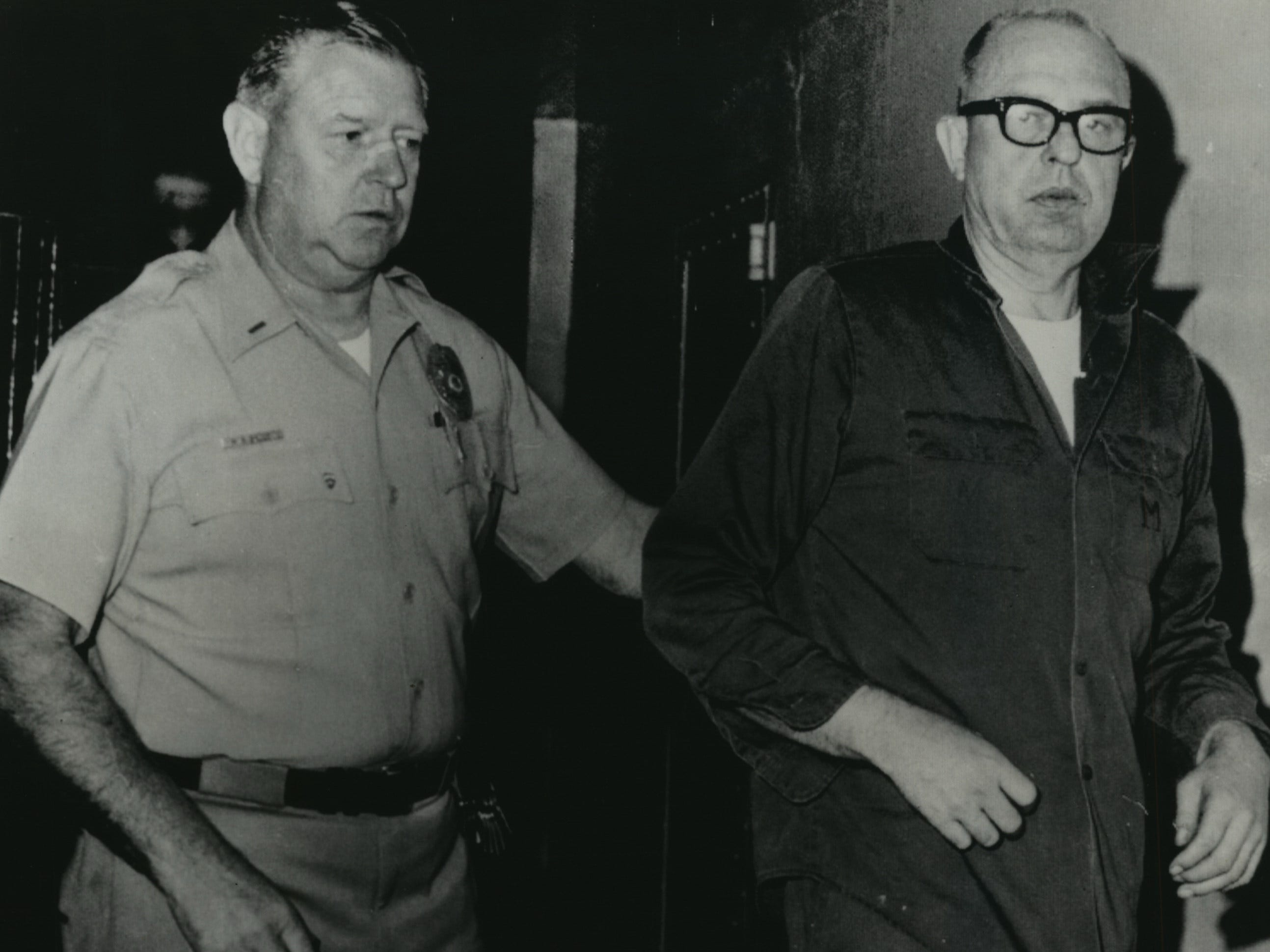 August Bergenthal, 47, accused of shooting industrialist Russell D.L. Wirth to death in Milwaukee, is taken to his cell in the San Diego city jail after questioning. He was arrested Sept. 21, 1968, the day after he allegedly shot and killed Wirth, a former associate. This photo was published in both the Milwaukee Sentinel and Milwaukee Journal on Sept. 23, 1968.