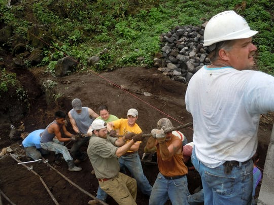 Mike Paddock (right) works in Guatemala with the group Engineers without Borders and the Rotary Engineer program.