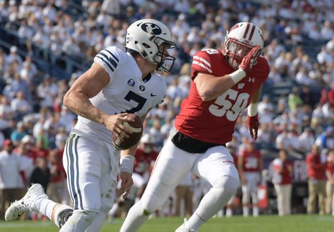 Wisconsin linebacker Tyler Johnson pressures BYU quarterback Beau Hoge during last year's game.