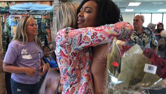 Supporters greet Miss Louisiana Holli' Conway on Monday as she returned from the Miss America competition in Atlantic City, New Jersey.