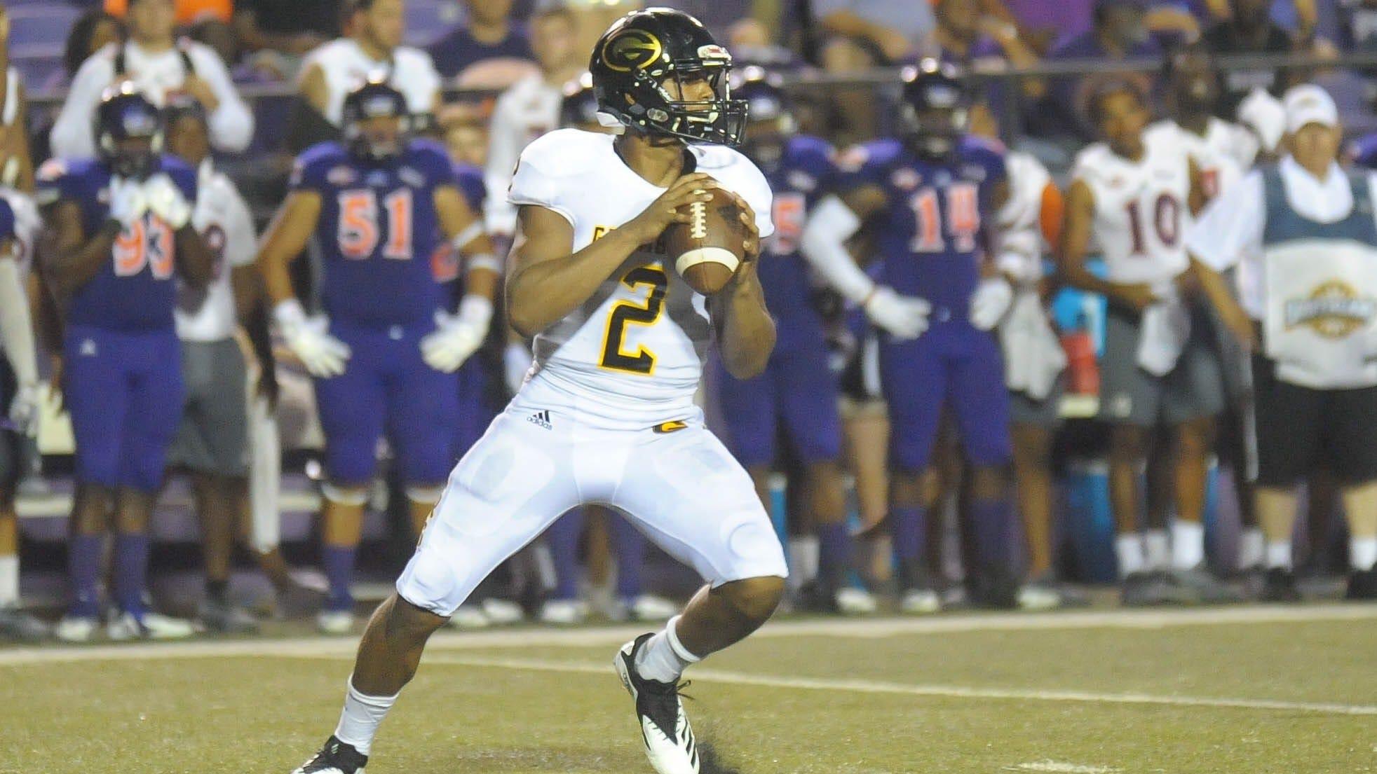 Grambling State redshirt freshman quarterback Aldon Clark (2) surveys the field against Northwestern State.