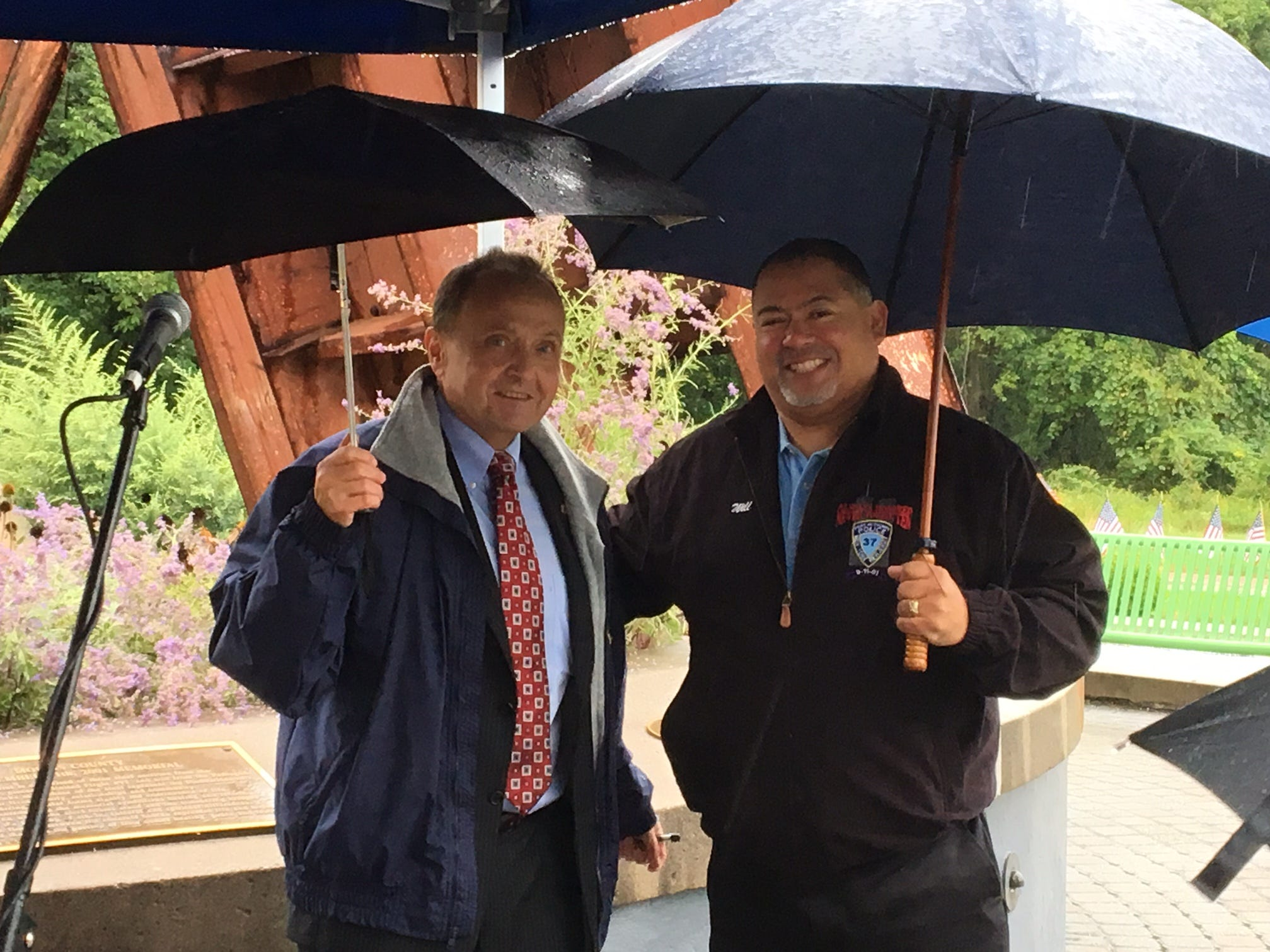 Former Port Authority Police Officer Will Jimeno, R, with Morris County Administrator John Bonanni