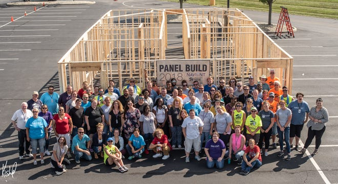 A group of Navient employees gathers after working with Habitat for Humanity for the 2018 Panel Build. More than 200 volunteers helped build a home for a longtime Muncie resident.