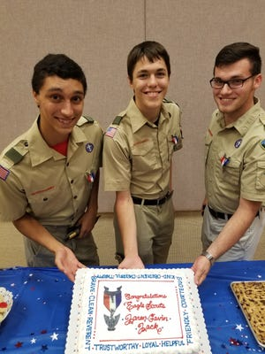 Jaren Olds (from left), Gavin Neal and Jack Jones, members of Boy Scout Troop 002, celebrate achieving the rank of Eagle Scout.