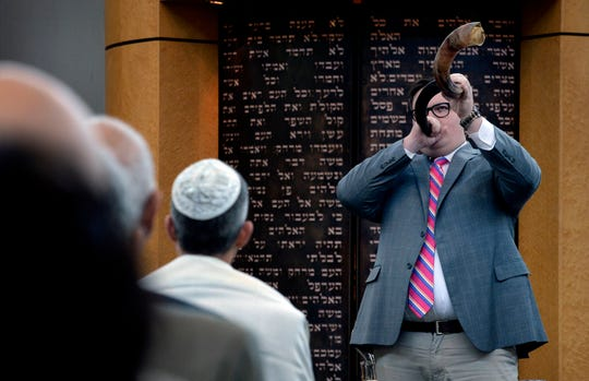 Bates O'Neal sounds the shofar during  the Rosh Hashanah service at Congregation Micah on Monday, September 10, 2018, in Brentwood, Tenn. O'Neal, who grew up at Congregation Micah, is now studying opera in New York.