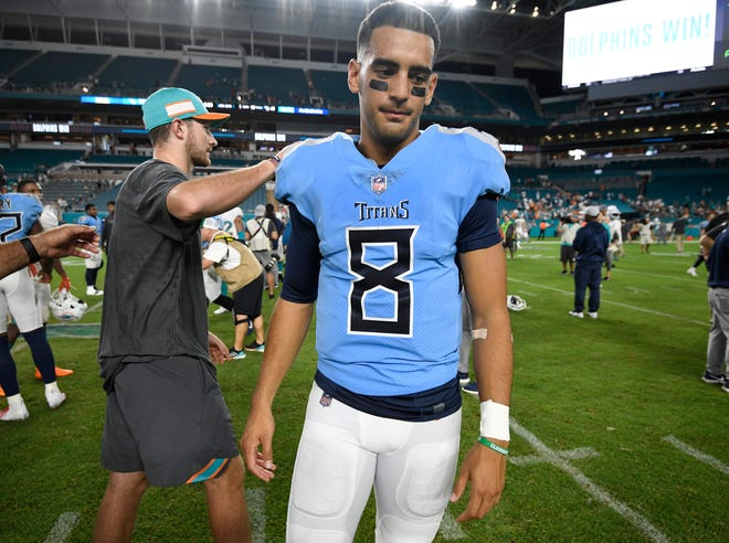 Titans quarterback Marcus Mariota (8) walks off the field after the team's loss to the Dolphins on Sunday.