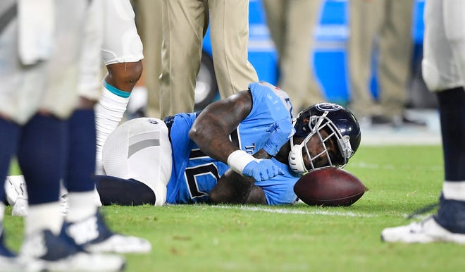Titans tight end Delanie Walker lies on the field in pain with an ankle injury in the fourth quarter Sunday.
