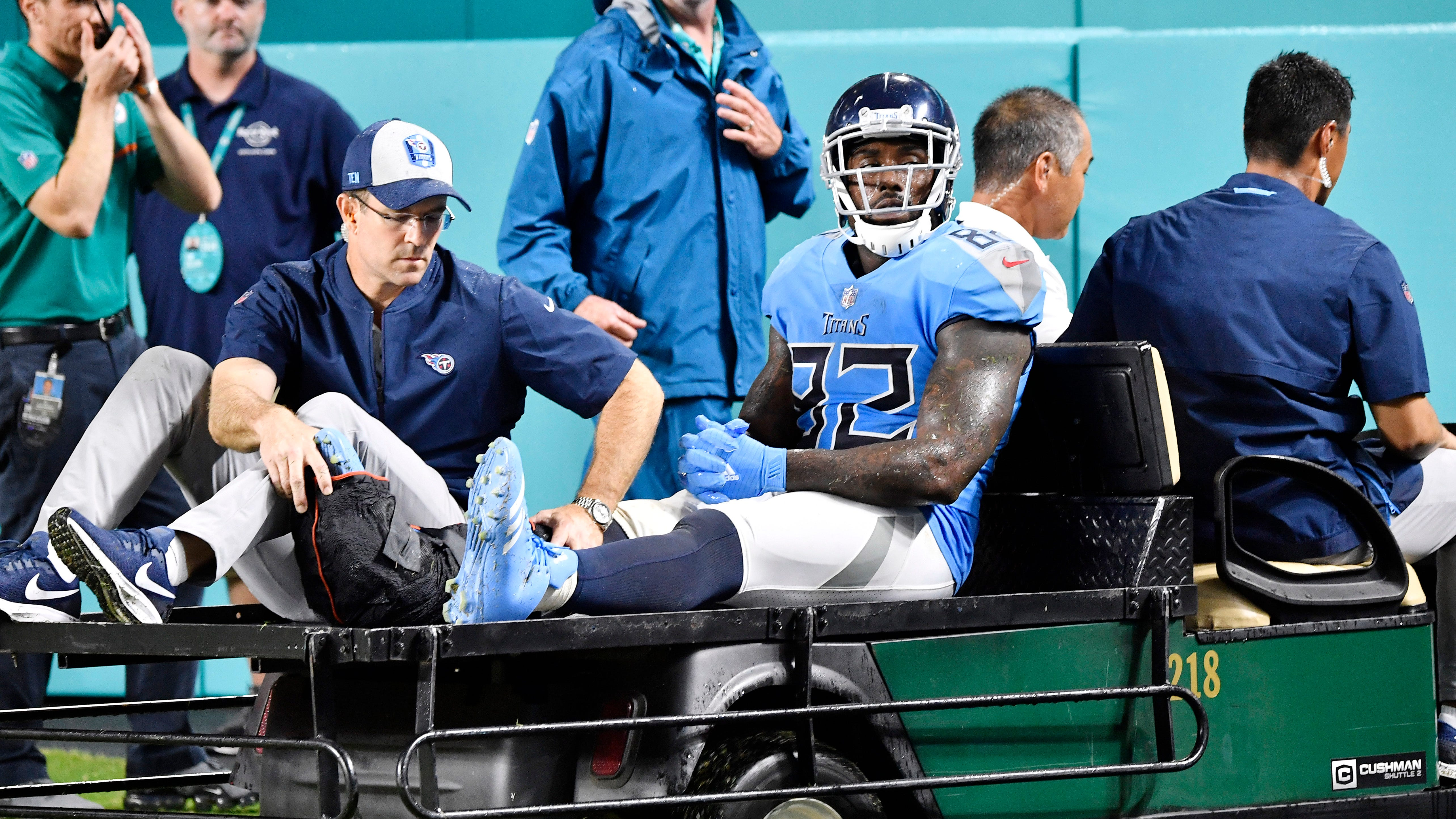 Titans tight end Delanie Walker (82) is carted...