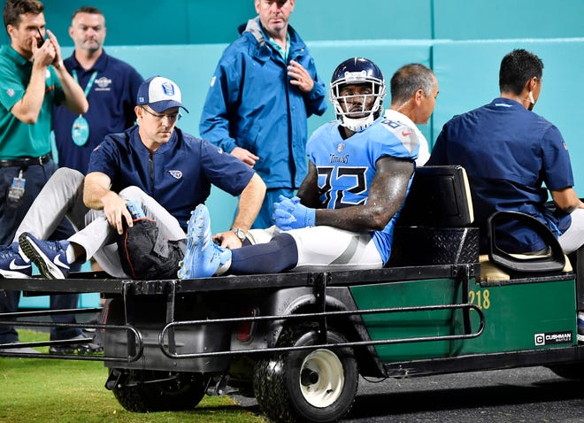 Titans tight end Delanie Walker (82) is carted off the field after an injury in the fourth quarter Sunday.