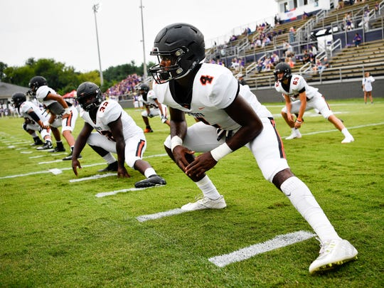 Ensworth's Keshawn Lawrence (4) stretches before the Tigers' Week 2 game at CPA.