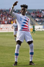 May 28, 2018; Chester, PA, USA; United States midfielder Tim Weah (11) reacts after forward Josh Sargent (not pictured) scores against Bolivia during an international friendly men's soccer match at Talen Energy Stadium.
