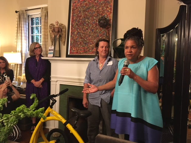 MaryAnne Howland,right,  a Nashville business leader, shares her son's positive experience with Alinker, a walking bike that serves as an alternative to a wheelchair.  Barbara Alink, middle, received $100,000 to grow Alinker from SheEO, founded by Vicki Saunders, left.