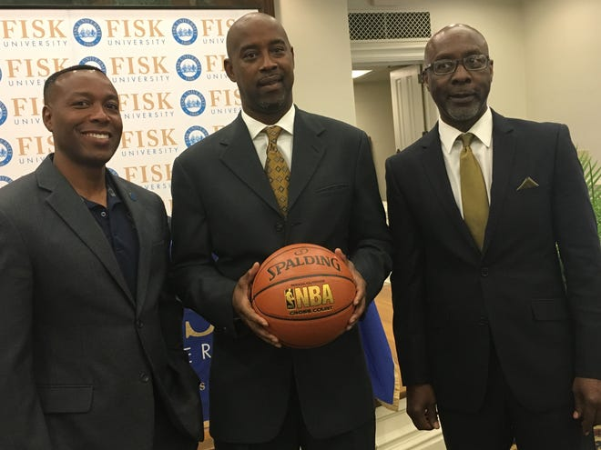 Kenny Anderson, center, was hired Monday as Fisk's new basketball coach. The former NBA All-Star is pictured here with Fisk President Kevin Rome, left, and athletics director Larry Glover.