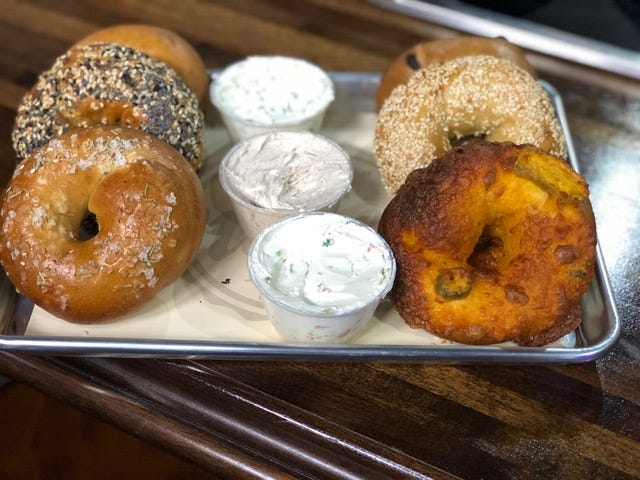 Assorted bagels and spread options from Bare Naked Bagel.