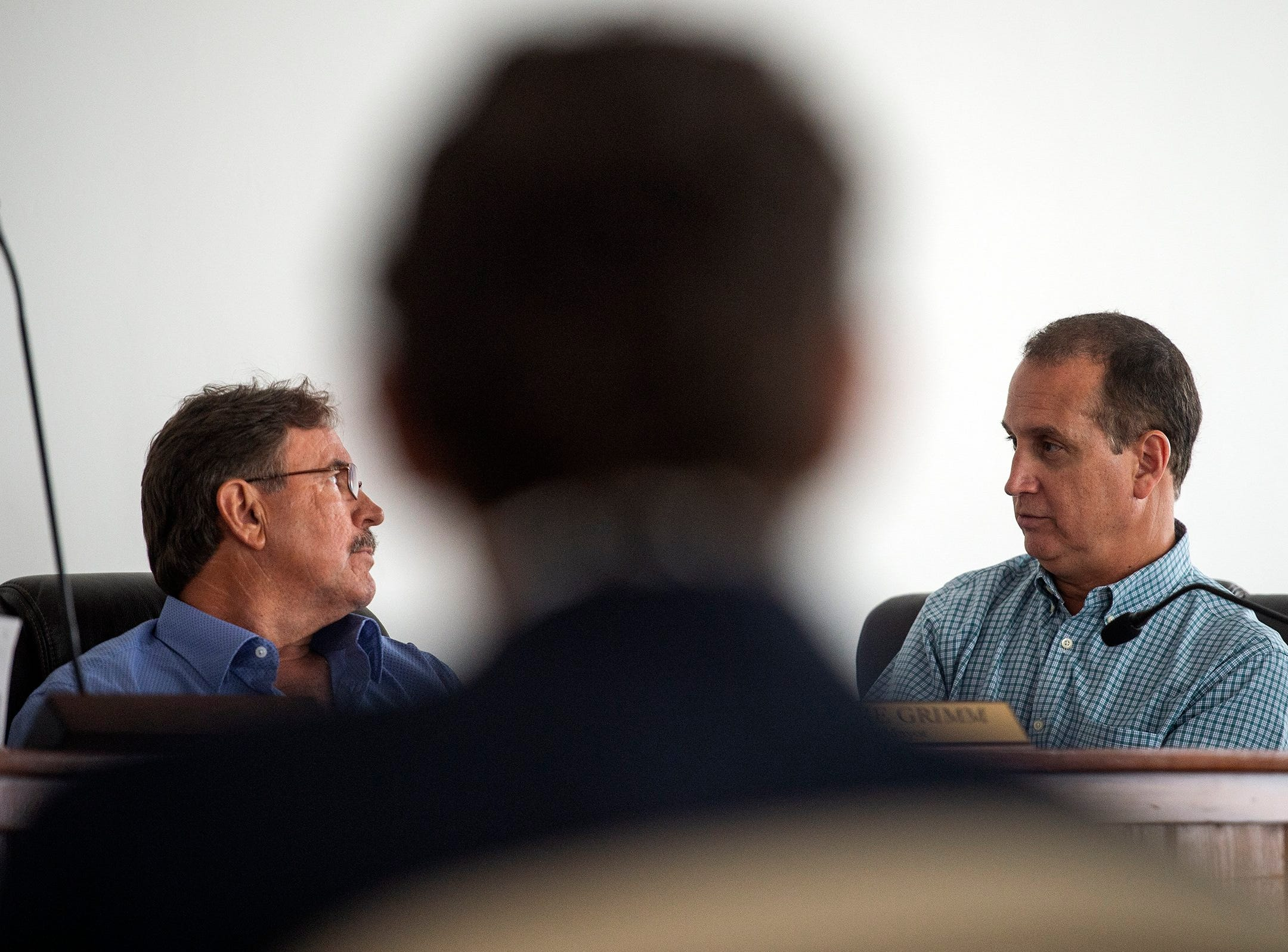 Everglades City Mayor Howie Grimm, left, and Congressman Mario Diaz-Balart talk during a press conference in Everglades City, Fla. on Monday, September 10, 2018. Elected officials took a tour of Everglades City, one of the areas hardest hit by Hurricane Irma, and discuseds the continued federal role in disaster recovery one year after Hurricane Irma landed in Florida.