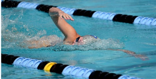 Barron Collier High School's Emma Feehery competes in the Shark Relays at Norris Pool in Naples on Saturday, Sept. 8, 2018.