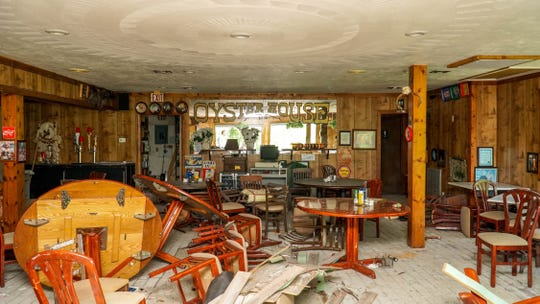 The Oyster House Restaurant in Everglades City was lifted off its foundation by Hurricane Irma, which also created a storm surge that pushed mud and water into the more than 30-year-old eatery.