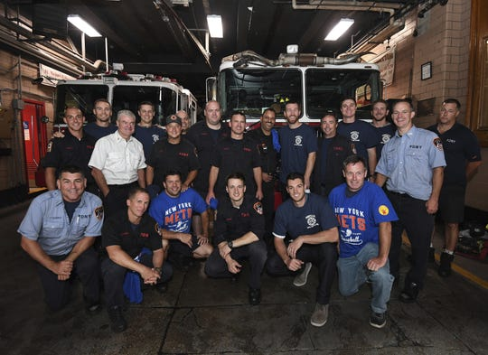 Mets players visit Engine 22/Ladder 13/Battalion 10 firehouse.