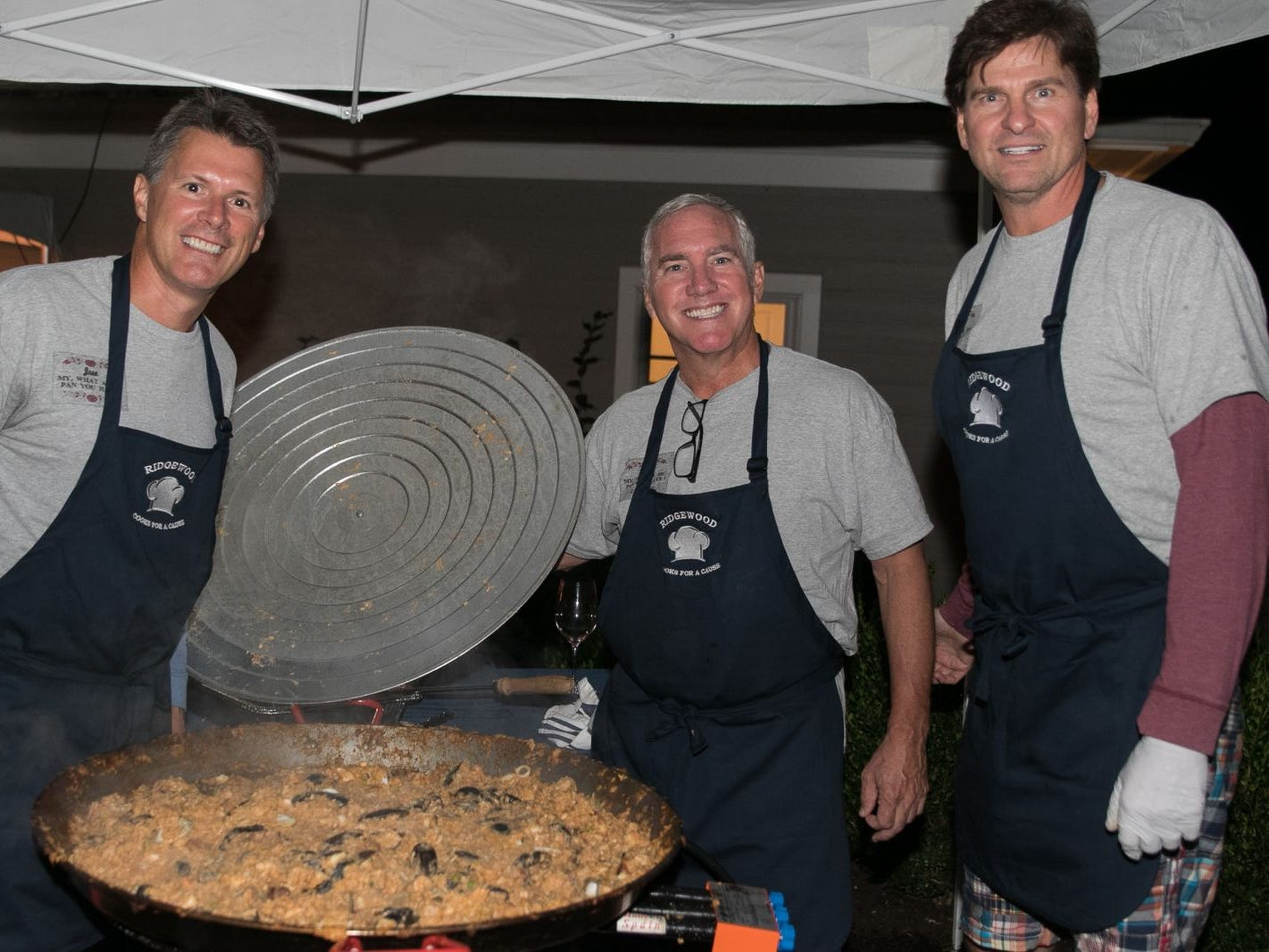 "Joe Scanlon, David Colin, Jeff Saladucha. Pam Chmiel, The Tres Amigos Paella Company (David Colin, Joe Scanlon and Jeff Saladucha), The Jims (Jim Gibney and Jim Toscano), George Nikias, Ron Oscher and Neil Murphy held Ridgewood Cooks for a Cause to benefit ""Cookies For Kids Cancer"" (Childhood Cancer Research) and YCS (Youth Consultaion Services) charities. 09/08/2018"