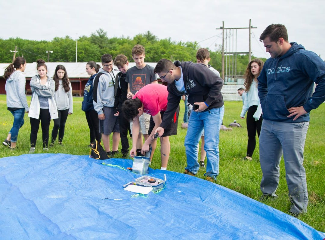 Students at Passaic Valley High School STEM class attach data package to weather balloon launch held at the end of last school year.