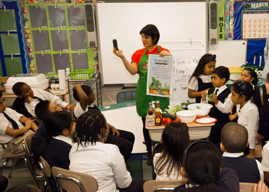 Veggiecator and Veggiecation owner Lisa Suriano shows children healthy meals they can make with cucumbers.