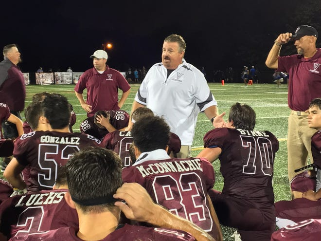 Verona football coach Kevin Batty addresses the team after a season opening victory over Caldwell.