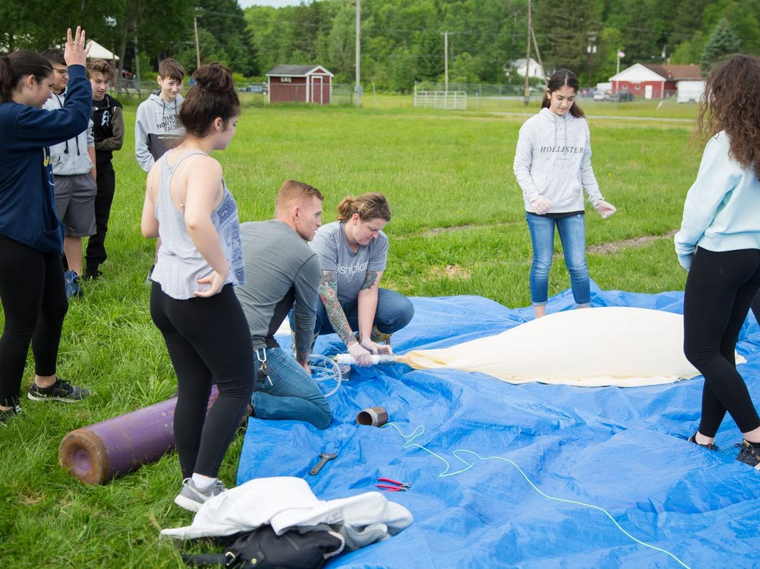 Filling weather balloon was a gas, gas, gas as the high school's first ever intro to STEM class winded down.