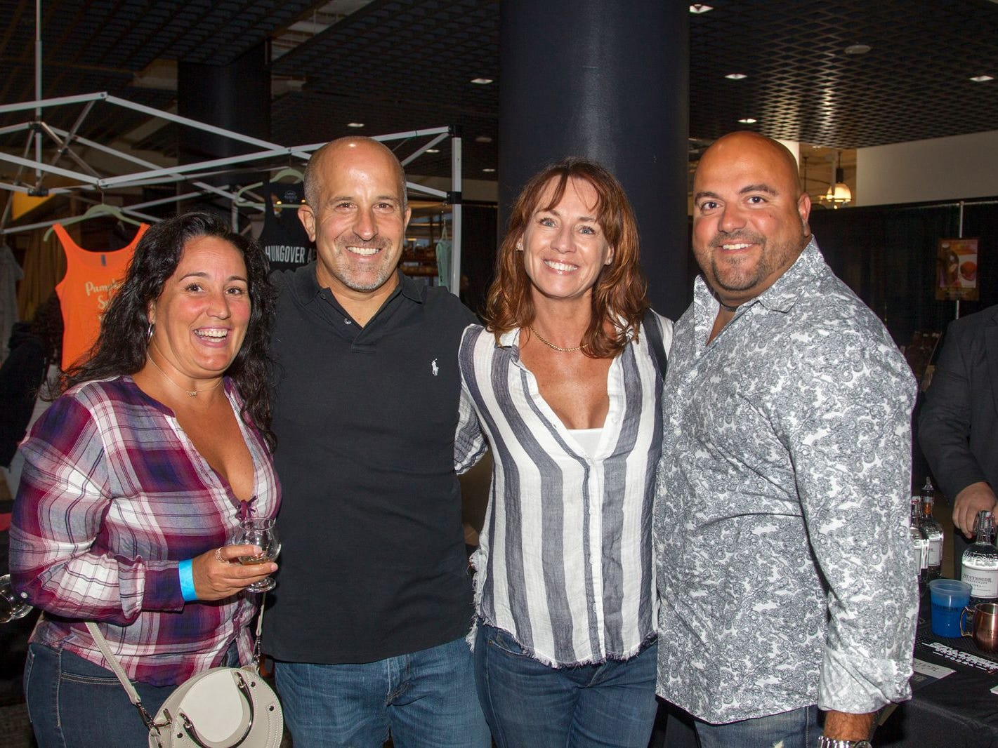 Angela, Mark, Helen, Chris. Jersey City Craft Distillery Fest at the Harborside Atrium featured more than 100 styles of spirits. Guests had the chance to taste craft-distilled spirits from moonshine, rum, cognac, whiskey, vodka, gin, tequila and more. 09/08/2018