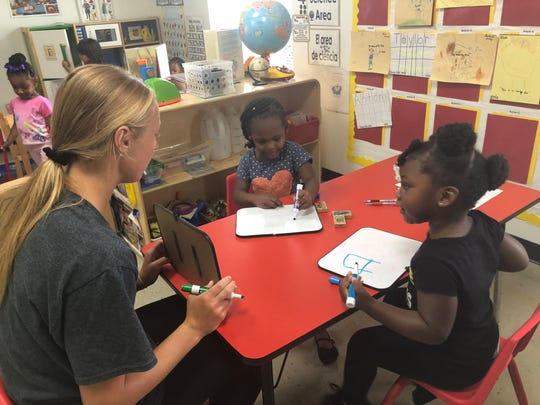 Northern Highlands girls soccer player Kyla Krawczyk works with kids at the Head Start program in Cottonwood, Tennesse.