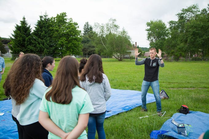 STEM teacher Randall Sanders addresses students  during a launch of weather balloons which they used to collect data.