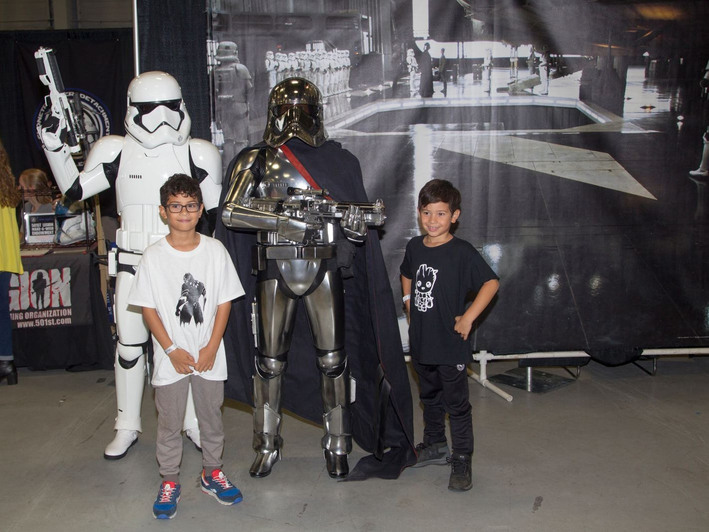 Fans pose for a picture with a Stormtooper and Captain Phasma. The 2018 Heroes and Villains Fan Fest took place at the New Jersey Convention & Expo Center. 09/09/2018