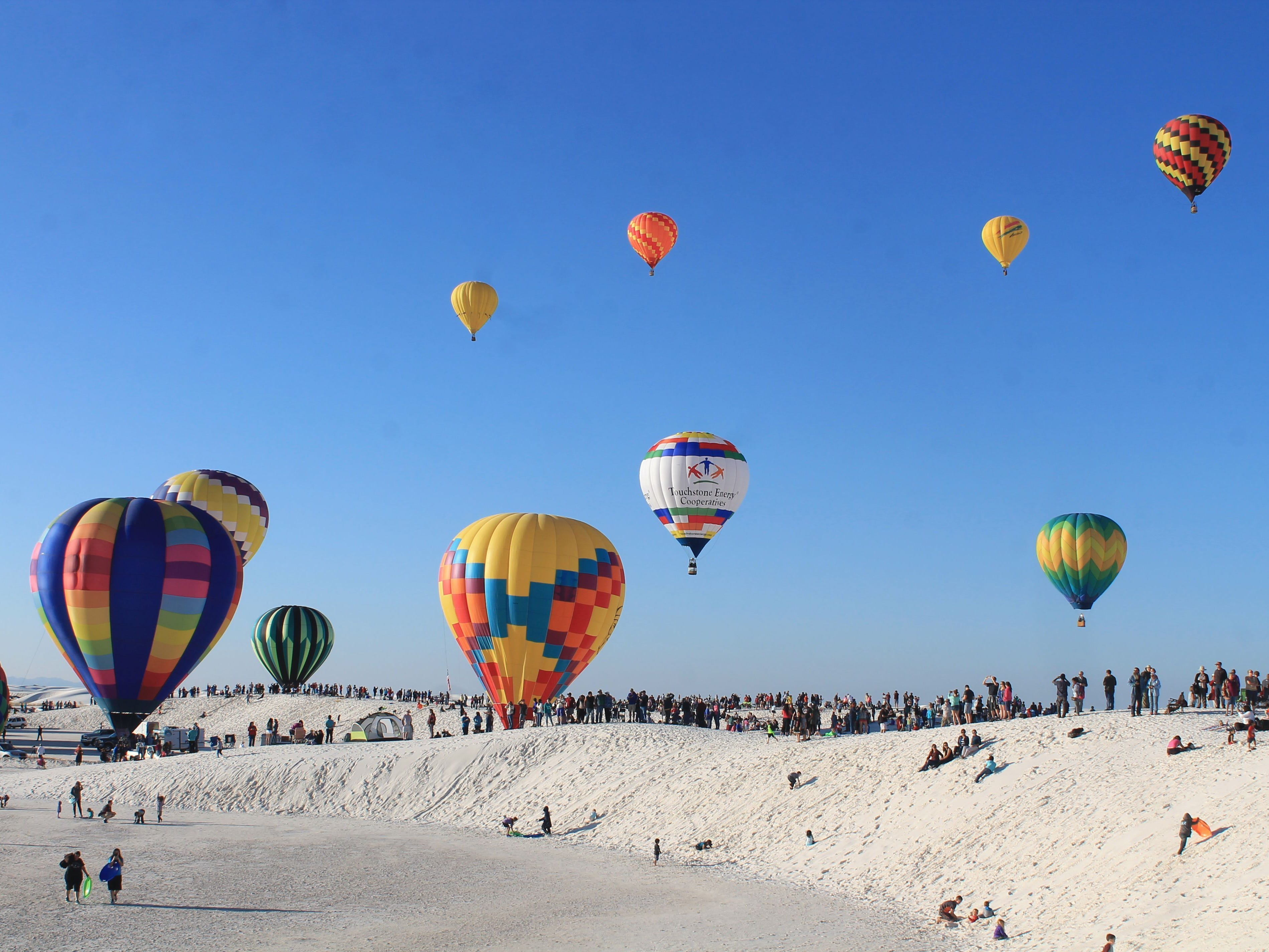 Hot air balloons launch at White Sands National Monument in 2016. This year's White Sands Balloon Invitational takes place Saturday, Sept. 15.