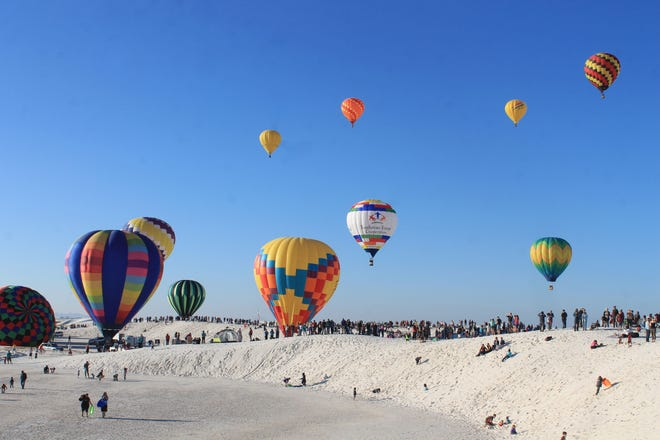 Hot air balloons launch at White Sands National Monument in 2016.  Events such as this one, and the Albuquerque International Balloon Fiesta draw tourists to the state and resulted in a $6.6 billion impact in 2017, officials said.